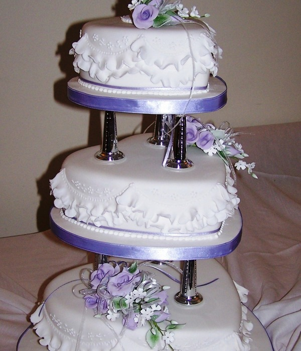 3 Tier Heart Shaped Cake On Pillars With Gumpaste Flowers