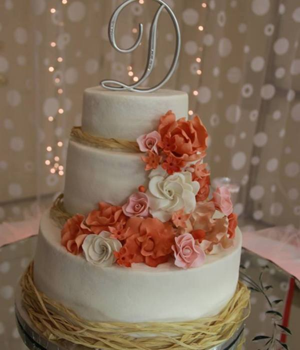 Wedding Cake With Sugar Flowers In Corals And Pinks And...