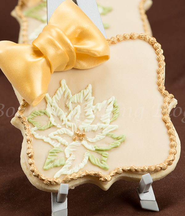 A Gluten Free Sugar Cookies Card Decorated With Brush Embroidery And Gumpaste Bows The Poinsettia Royal Icing Coloured With Vine Green For...