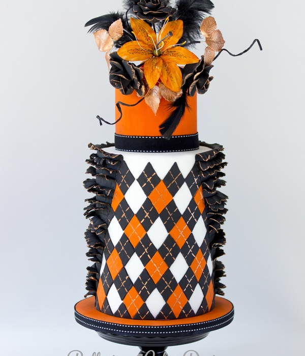 Black And Orange Argyle Inspired Double Barrel Cake With A Touch Of Gold