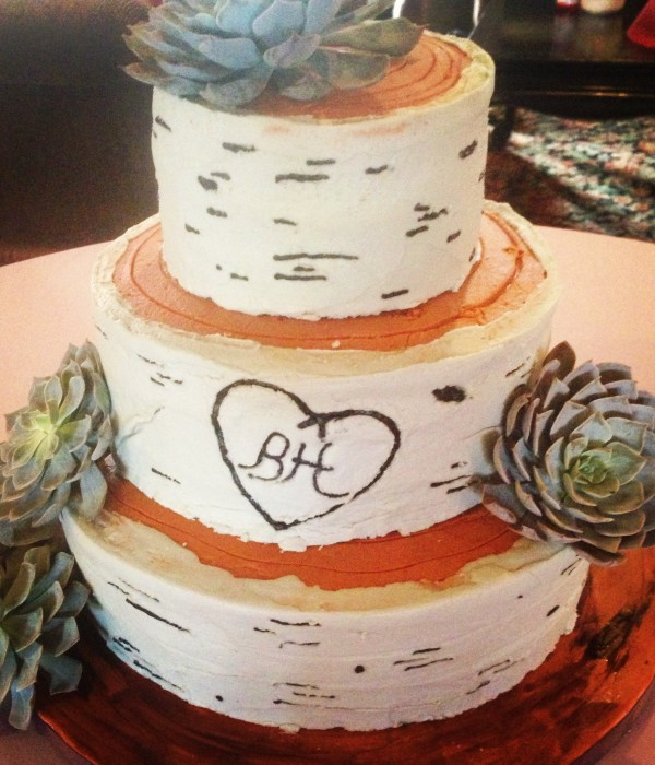 A Birch Wood Inspired Wedding Cake With Fresh Succulents...
