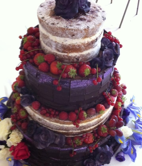 Wedding Cake Decorated With Chocolate Slabs Fruit And Sugar...