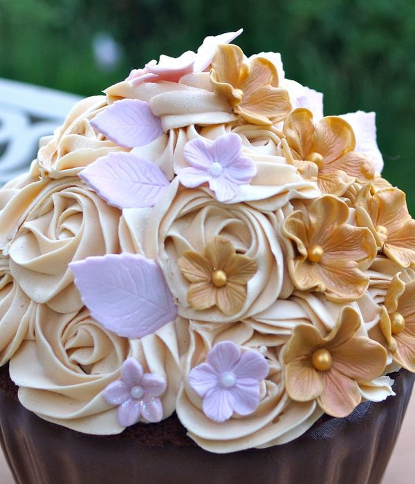 A Giant Chocolate And Caramel Cupcake Decorated With Sugar...