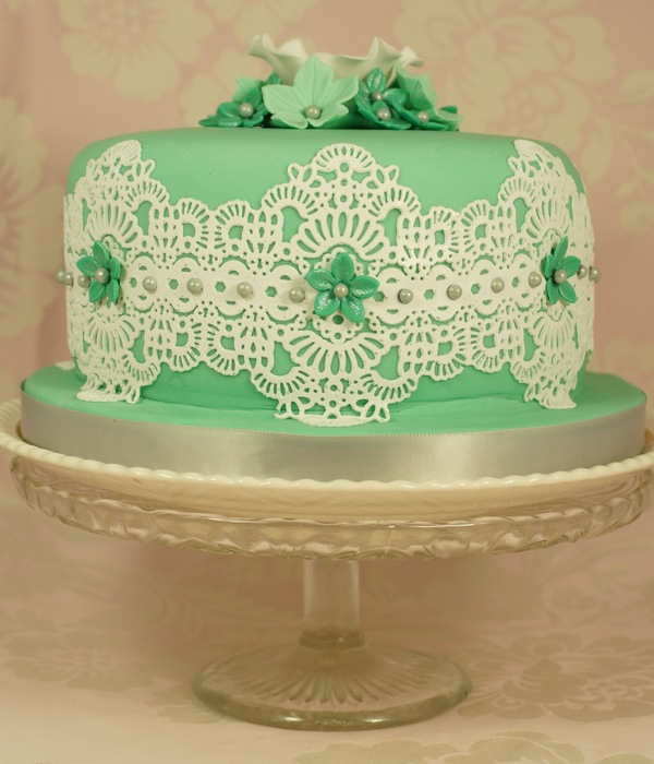 A Six Inch Birthday Fruit Cake Decorated With Cake Lace And...