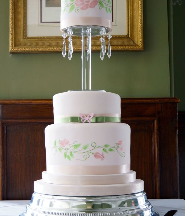 A Three Ties Wedding Cake With Jewels One Tier Vanilla