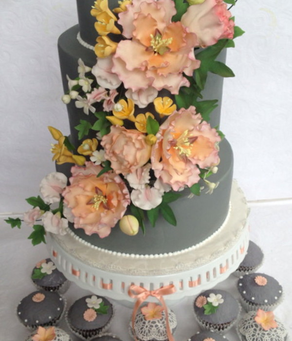 Wedding Cake And Matching Cupcakes With Sugar Flowers And Edible Lace