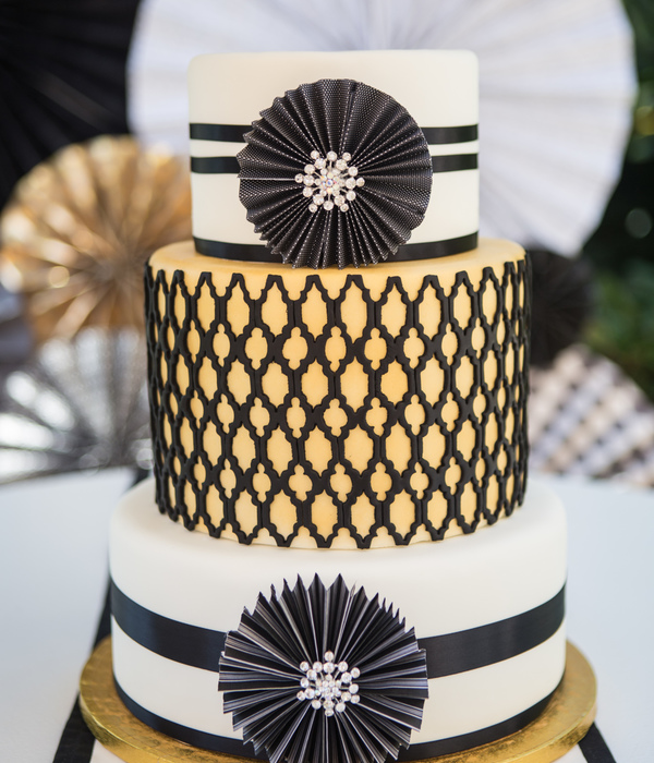 Black White And Gold Wedding Cake Incorporating The Paper Wheels And Some Bling With A Quatrefoil Center Tier