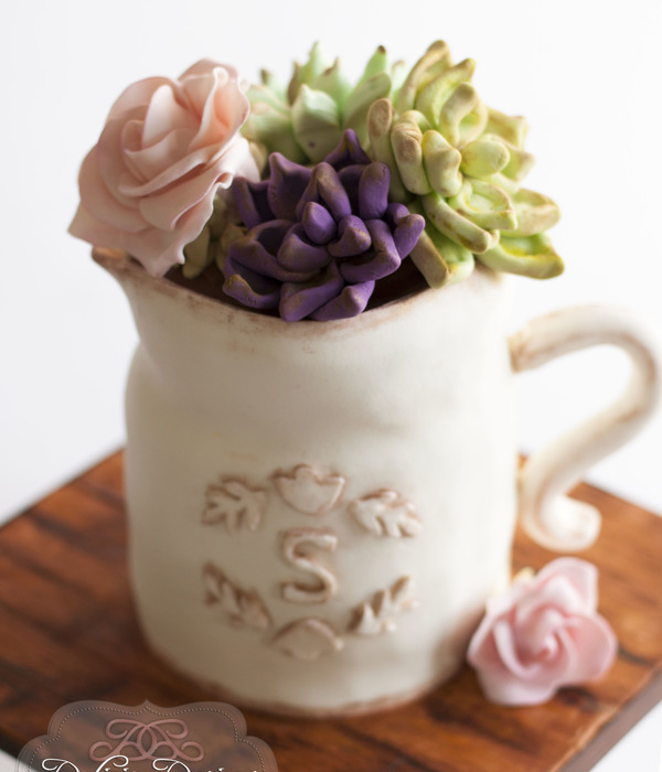 Pitcher Of Succulents