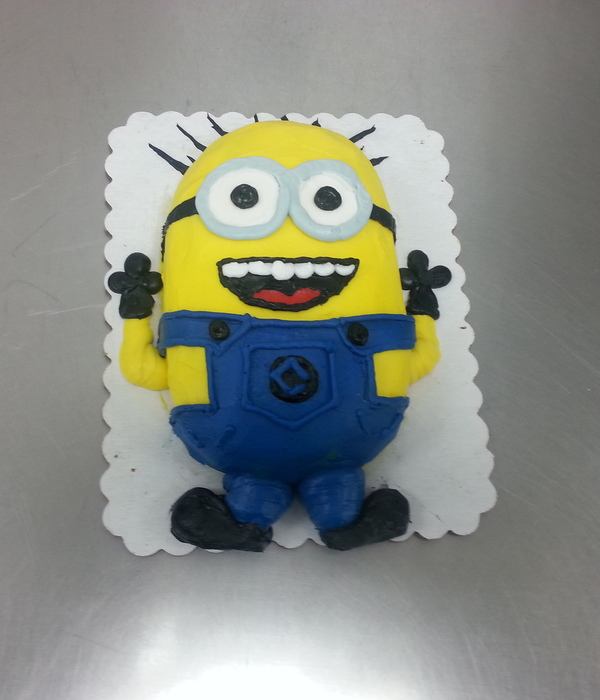 This Is A 18 Sheet Cake Cut And Iced In Buttercream Icing In The Theme Of A Minion From The Despicable Me Movies