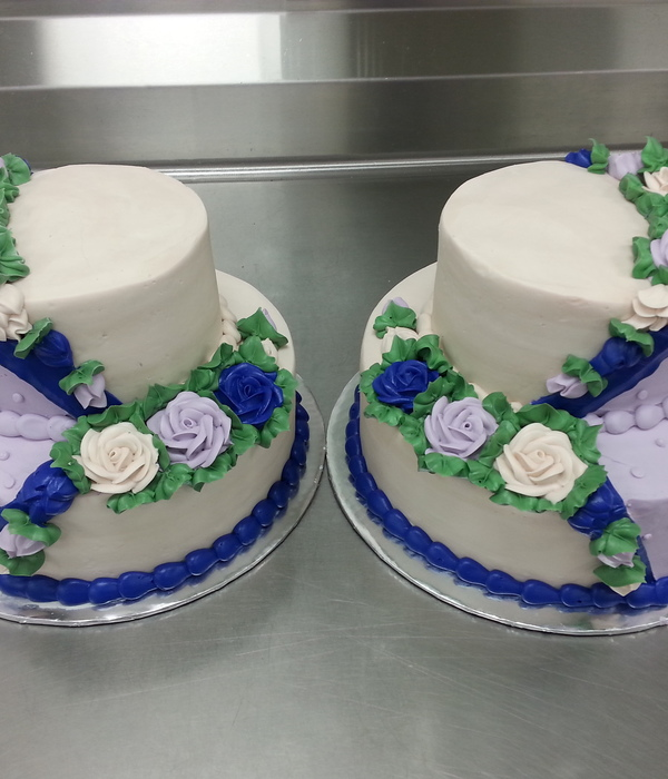 Twin 2 Tier Wedding Cakes With Buttercream Icing In A...