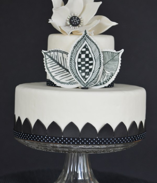 Black And White Cake With Lotus And Mehndi Design Leaves