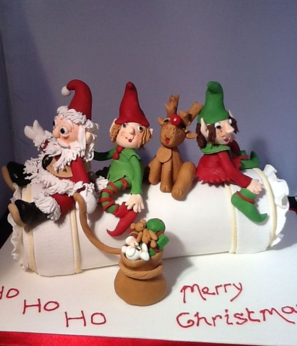 Santa And His Helpers On A Christmas Cake Cracker