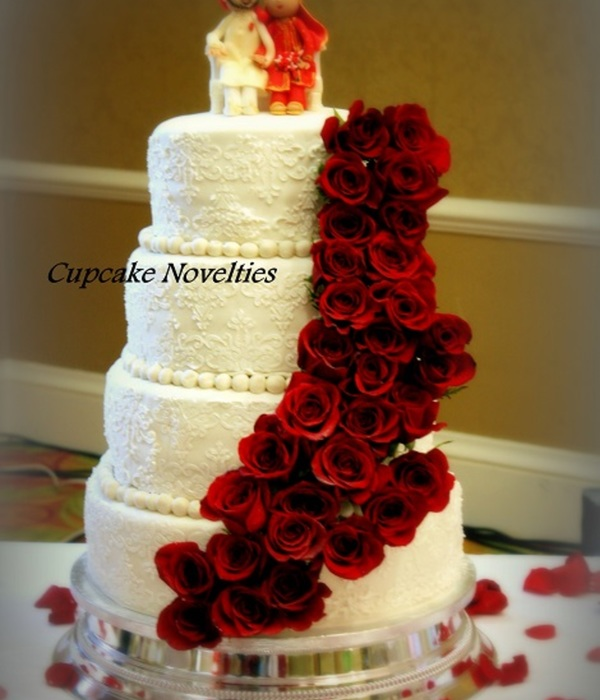 Whiteivory Lace Wedding Cake Adorned With A Cascade Of...