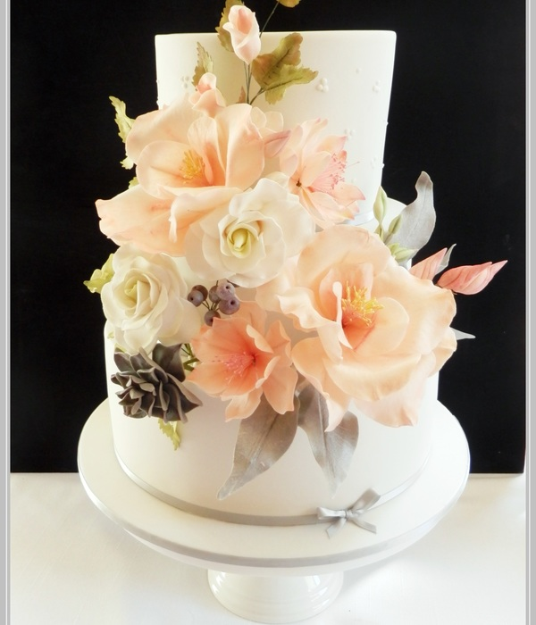 3 Tier Chocolate Wedding Cake With A Riot Of Sugar Flowers...