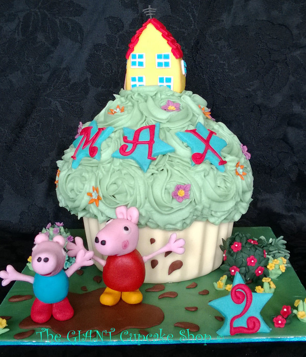 Giant Cupcake Peppa Pig And George Pig Splashing In Puddle