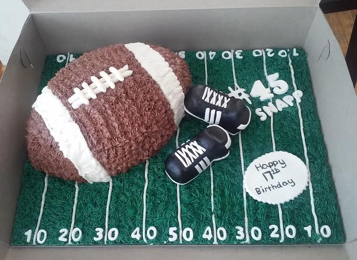 Football Shaped Themed Birthday Cake