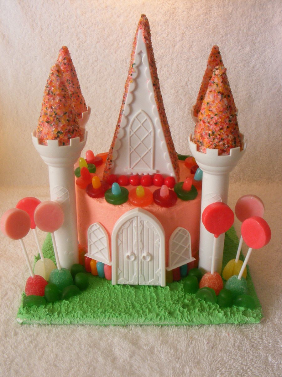 Candy Castle Cake Using The Wilton Castle Cake Set The Board Is Covered In Royal Icing And Then I Dabbed It With A Sponge For A Grassy Ef on Cake Central