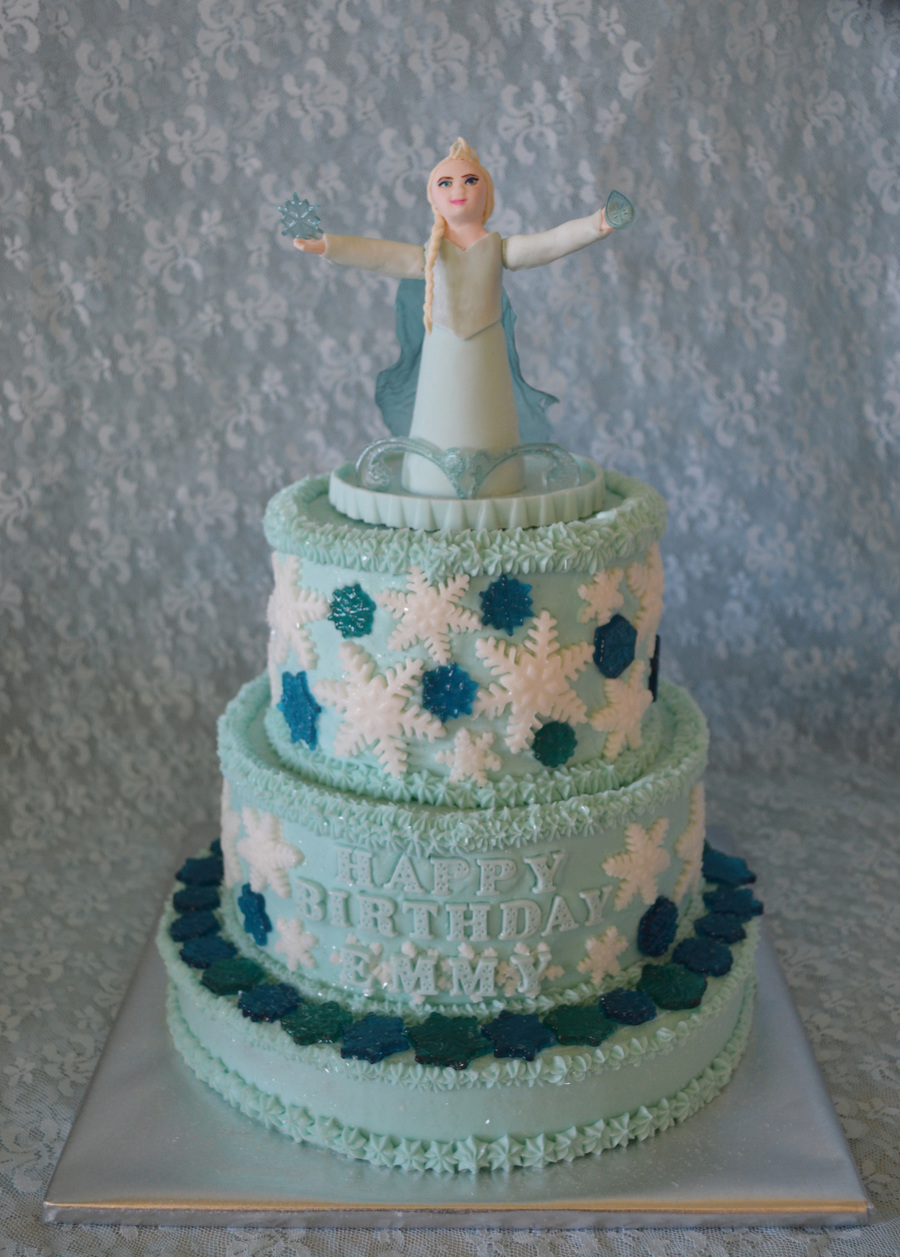 Frozen Themed Cake With Gumpaste Elsa Topper Rolled Buttercream White Snowflakes And Hard Candy Blue