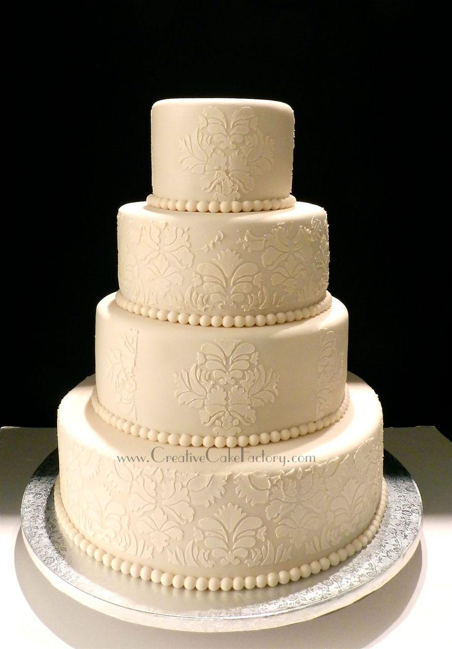 Ivory Damask Wedding Cake - CakeCentral.com