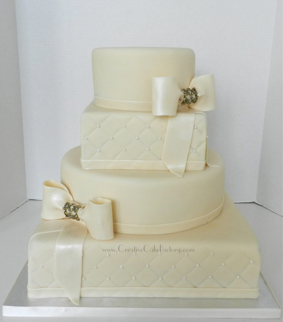 Ivory Bows Wedding Cake on Cake Central