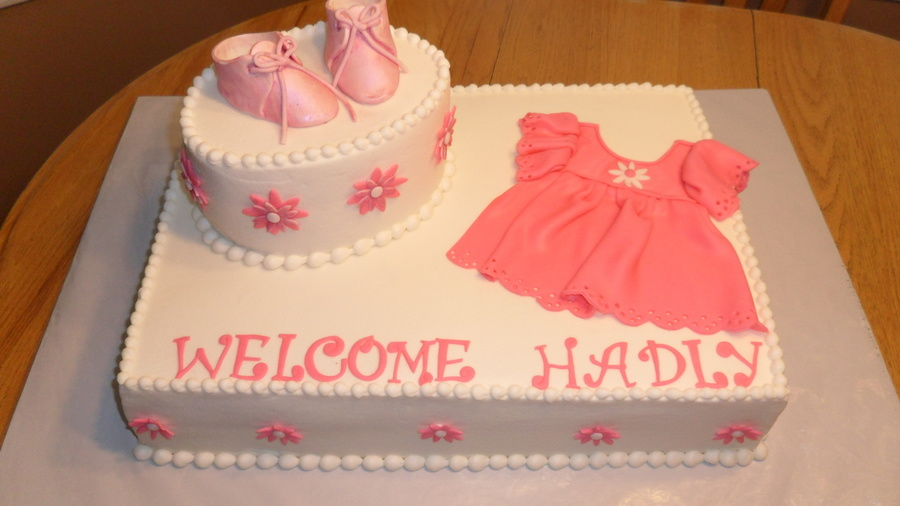 Pink Dress And Booties Baby Shower Cake - CakeCentral.com
