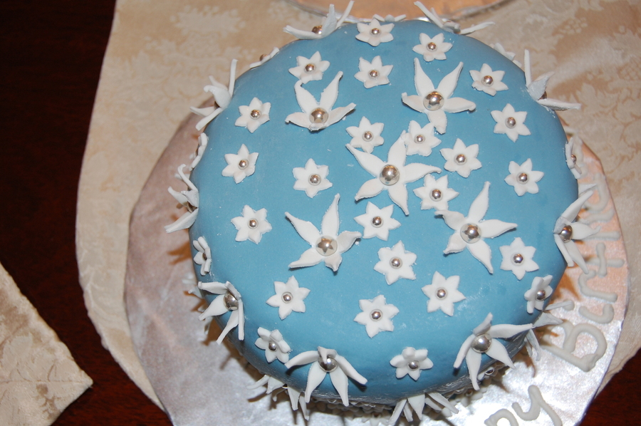 Simple Flower On Blue Birthday Cake on Cake Central