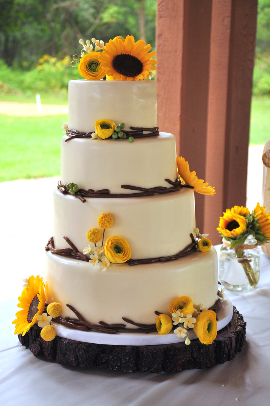 Modern rustic wedding cake for an outdoor wedding 4 offset tiers modern rustic wedding cake for an outdoor wedding 4 offset tiers with fondant twig border and handmade sugar flowers consisting of sunflowers ranunculus junglespirit Gallery