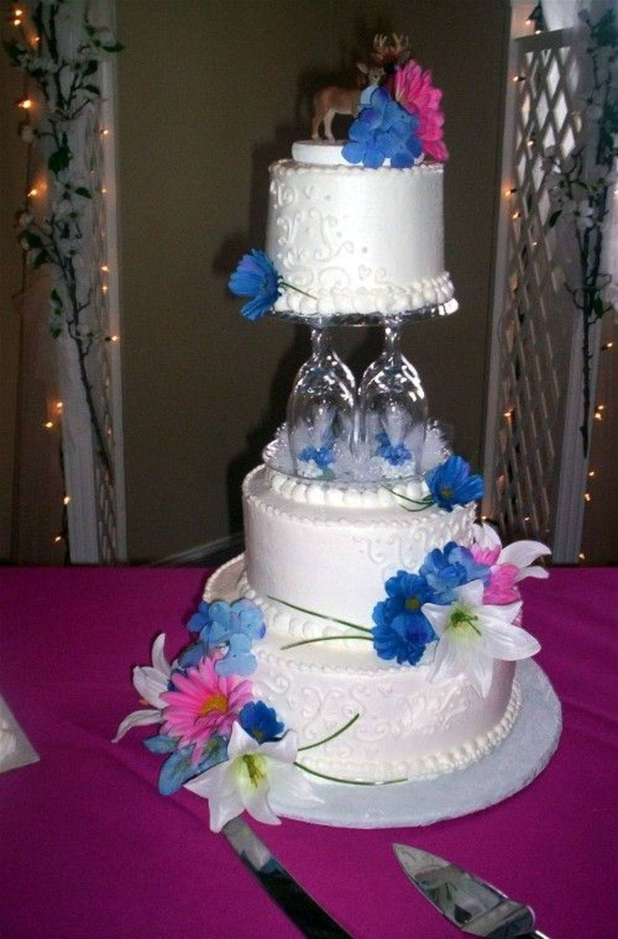 Three Tiered With Wine Glasses As Pillars Cakecentral Com