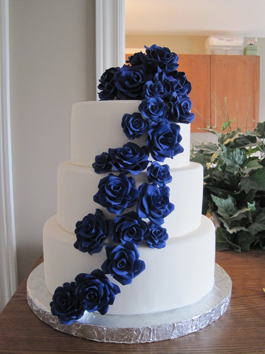 wedding cake with blue roses cascading sugar roses wedding cake cakecentral 26830