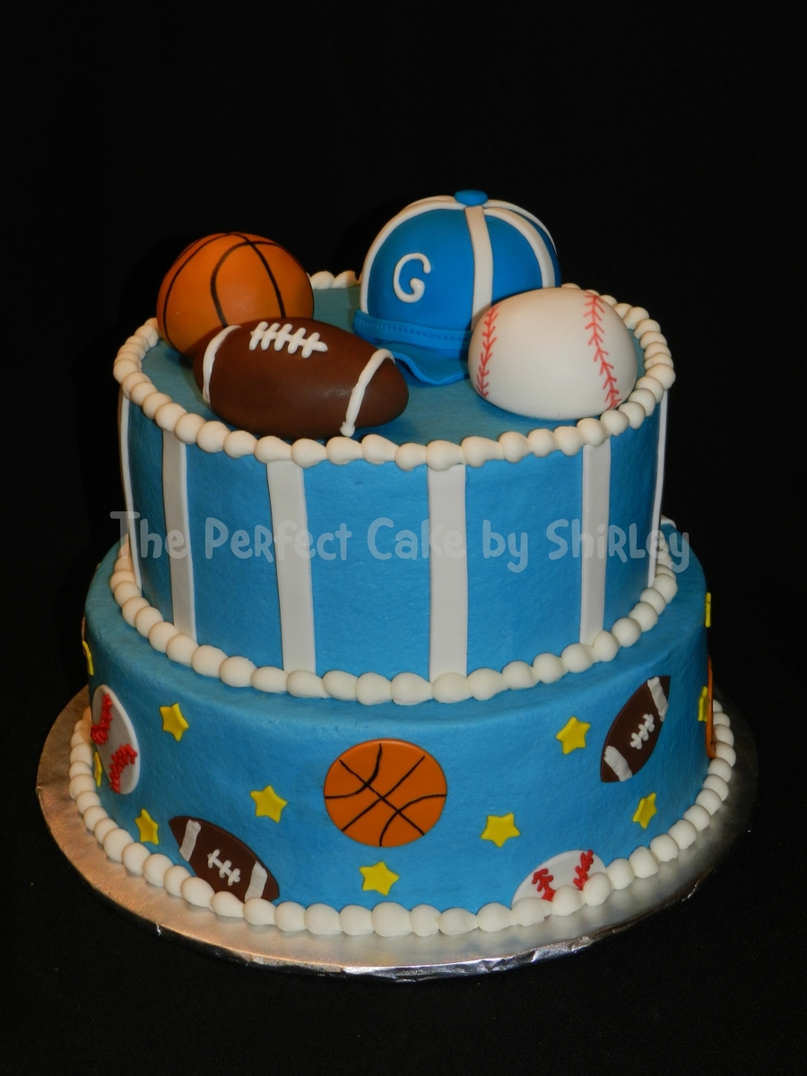 cake for a sports themed baby shower iced in buttercream fondant