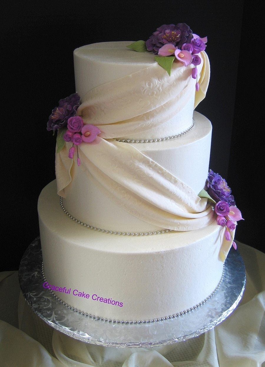 purple calla lily wedding cakes ivory wedding cake with fondant swag and purple 18894