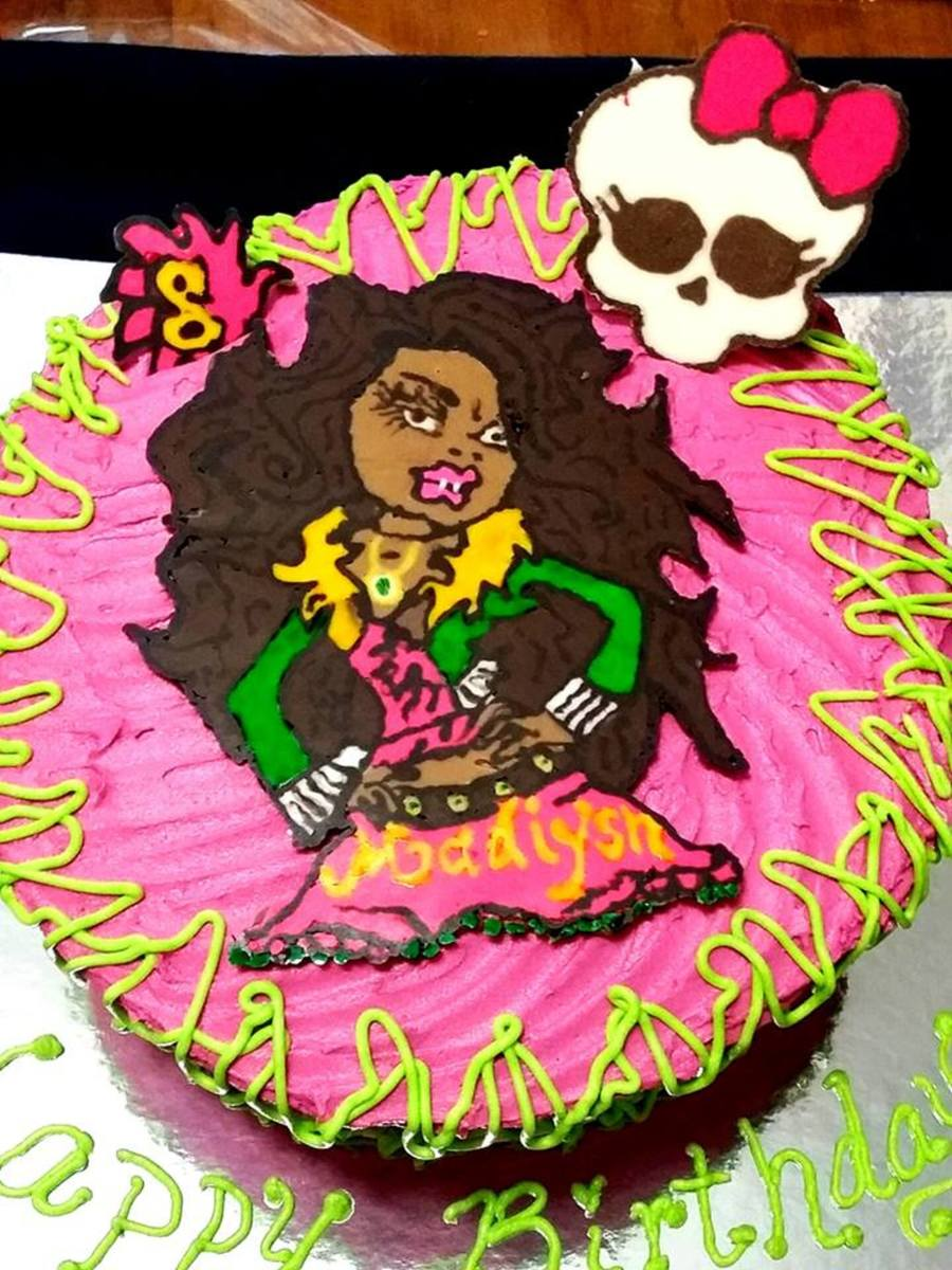 Clawdeen Wolf From Monsters High Bc 2 Layer Cake Was Swirled In Pink For A Girls Birthday Party Skull And Clawdeen And 8 Are Candy M Cakecentral Com