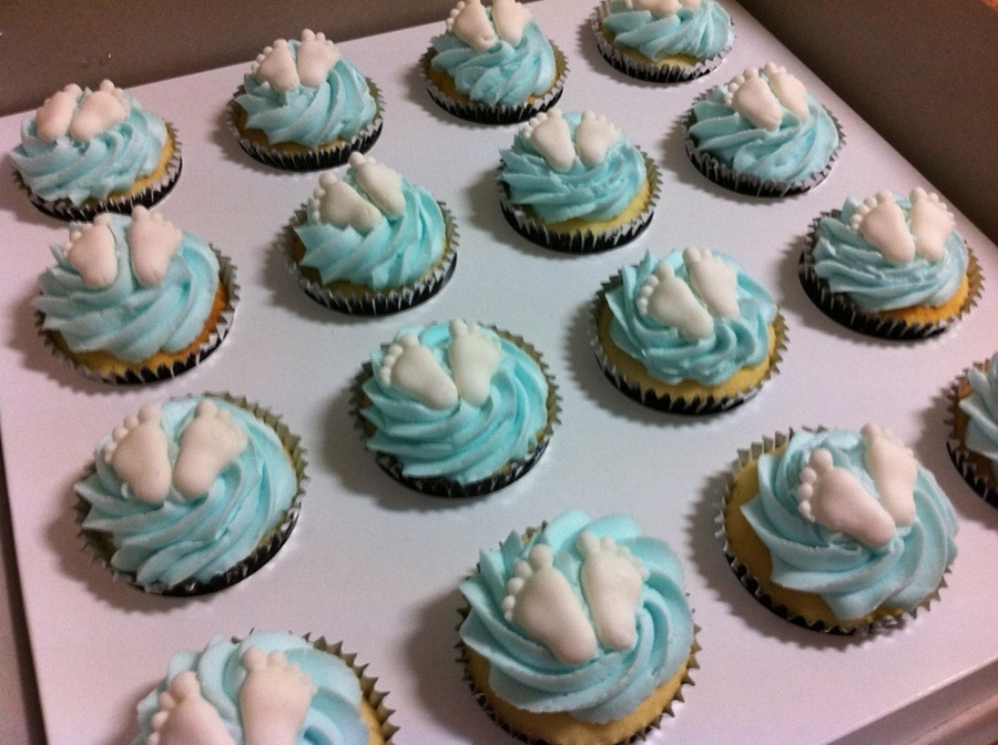 Baby Shower Cupcakes Blue ~ Light blue cupcakes with white baby feet for baby shower