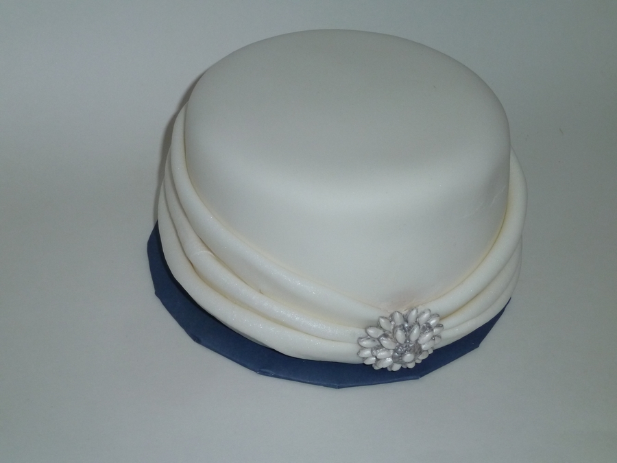 White Fabric And Brooch on Cake Central