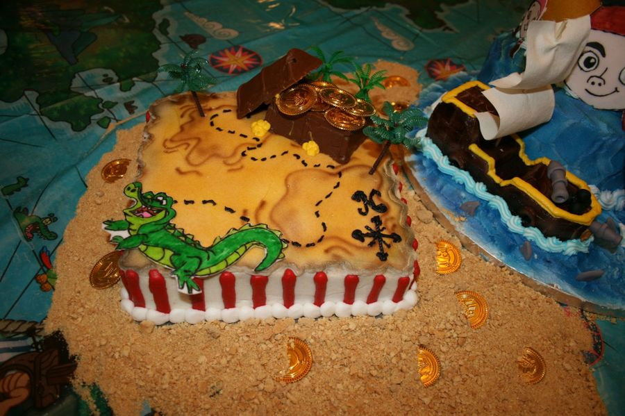 8 Square Cake Iced And Decorated In Buttercream With A Chocolate Treasure Chest Fondant Gator The 2 Tier Has Characters Map
