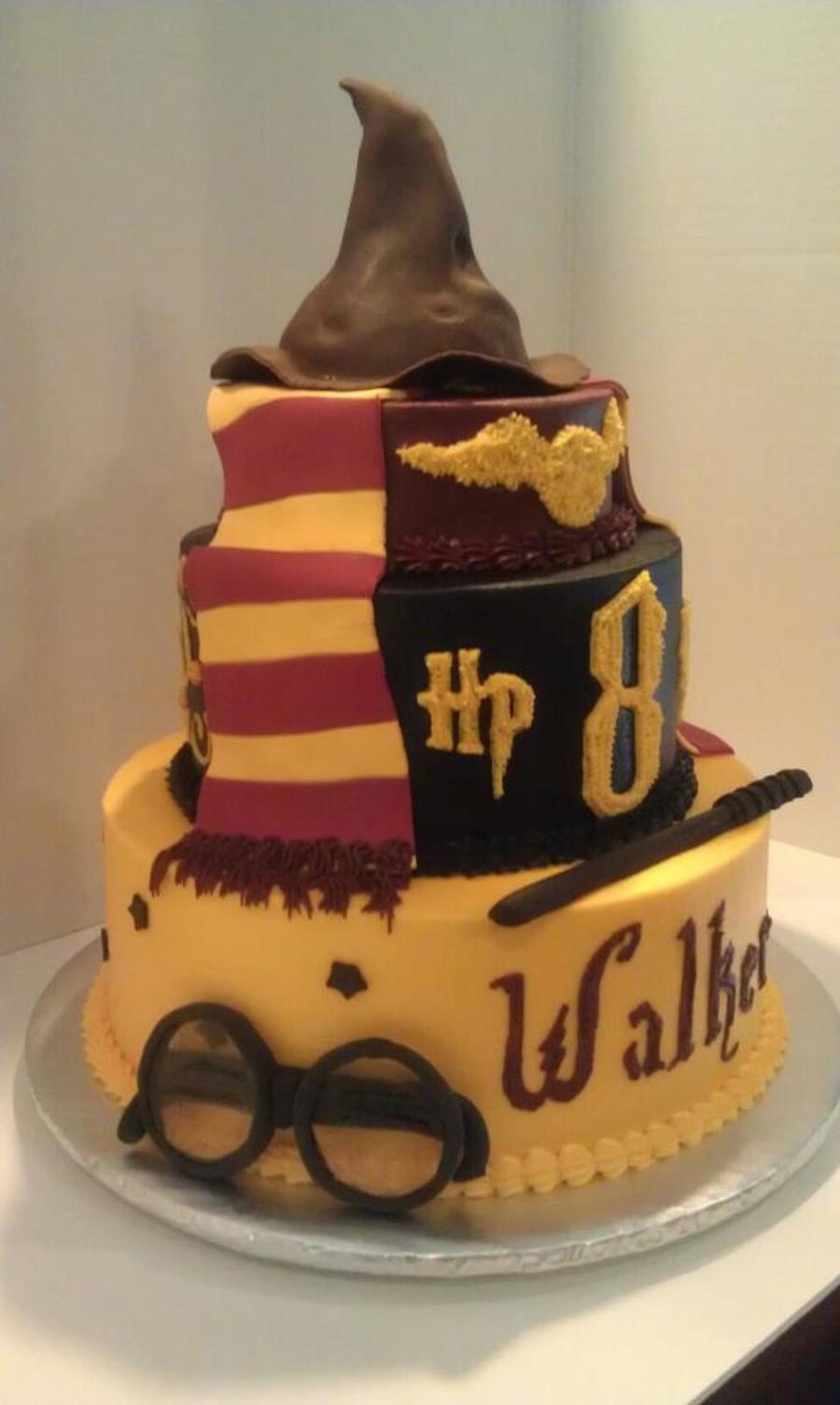 Harry Potter Cake In Buttercream With Fondant Trim Scarf Wand And Hat Glasses Are Made Of Dugar Glass Candy