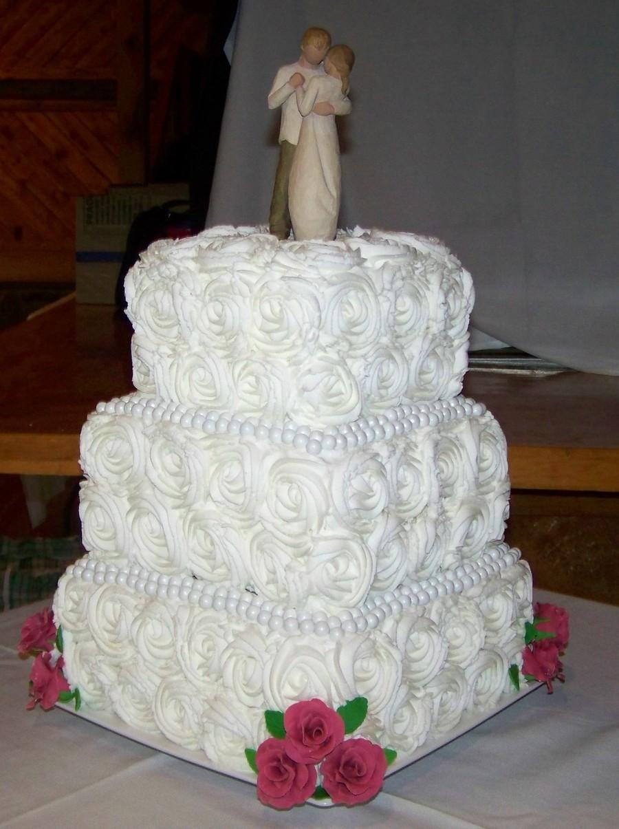 4 tiered white square wedding cake with pearlised, diamond