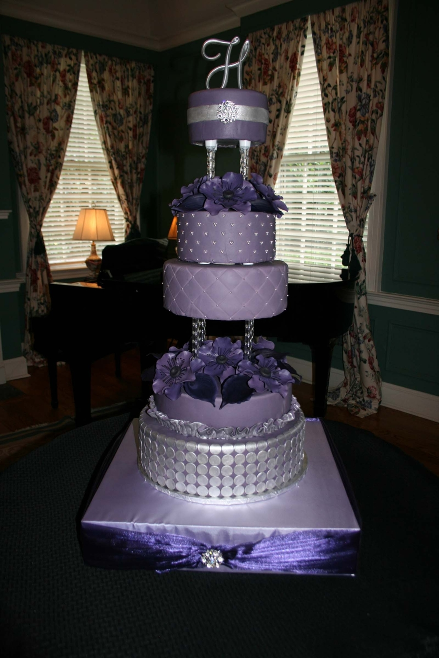 Purple wedding cake cakecentral purple fondant with silver fondant and silver dragees sugar flowers anenomes and calla lillies junglespirit Image collections