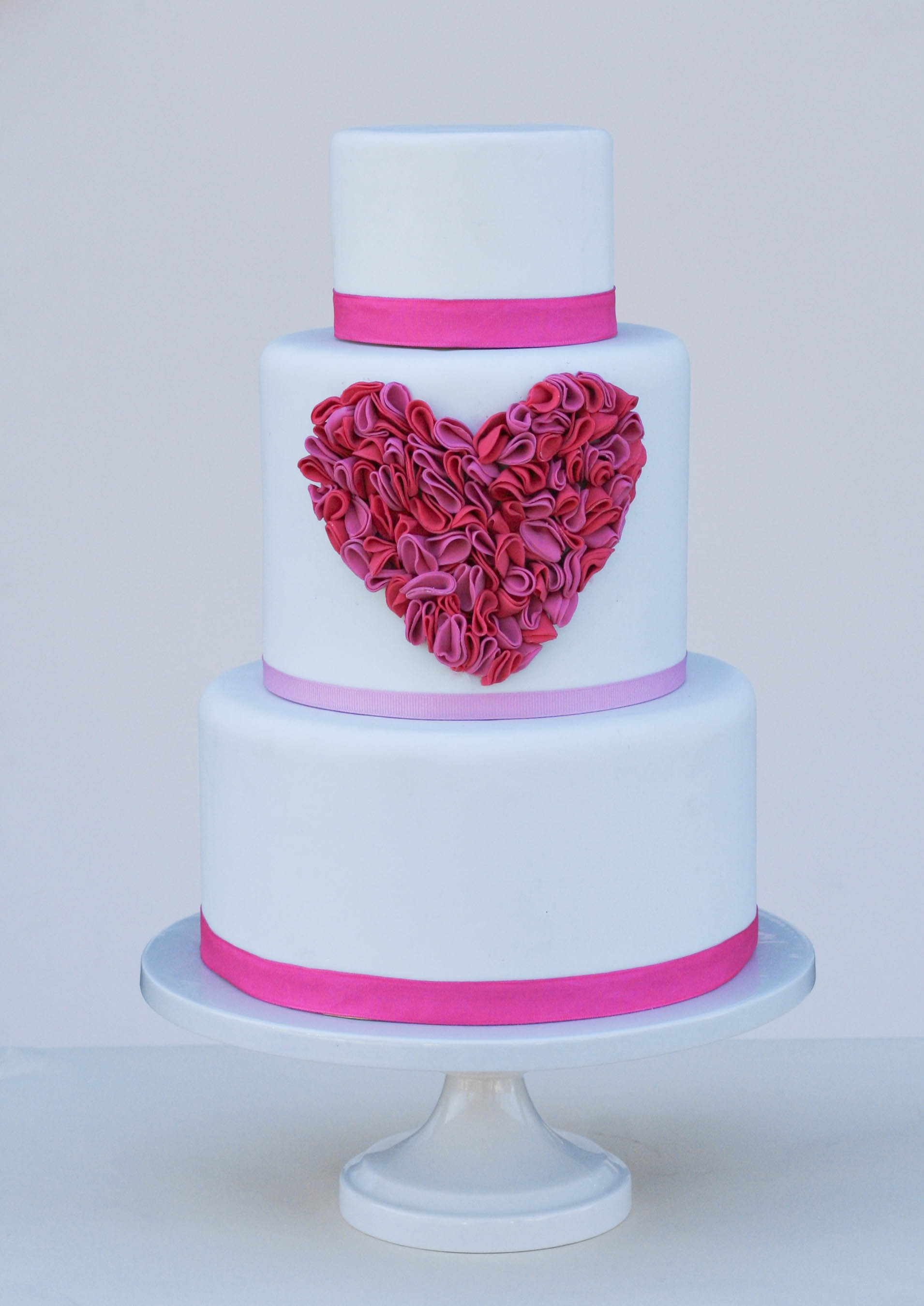 Two Toned Ruffled Fondant Heart On White Fondant With Grosgrain Ribbon Perfect For Valentines Day But Absolutely Adorable Any Time Of The on Cake Central
