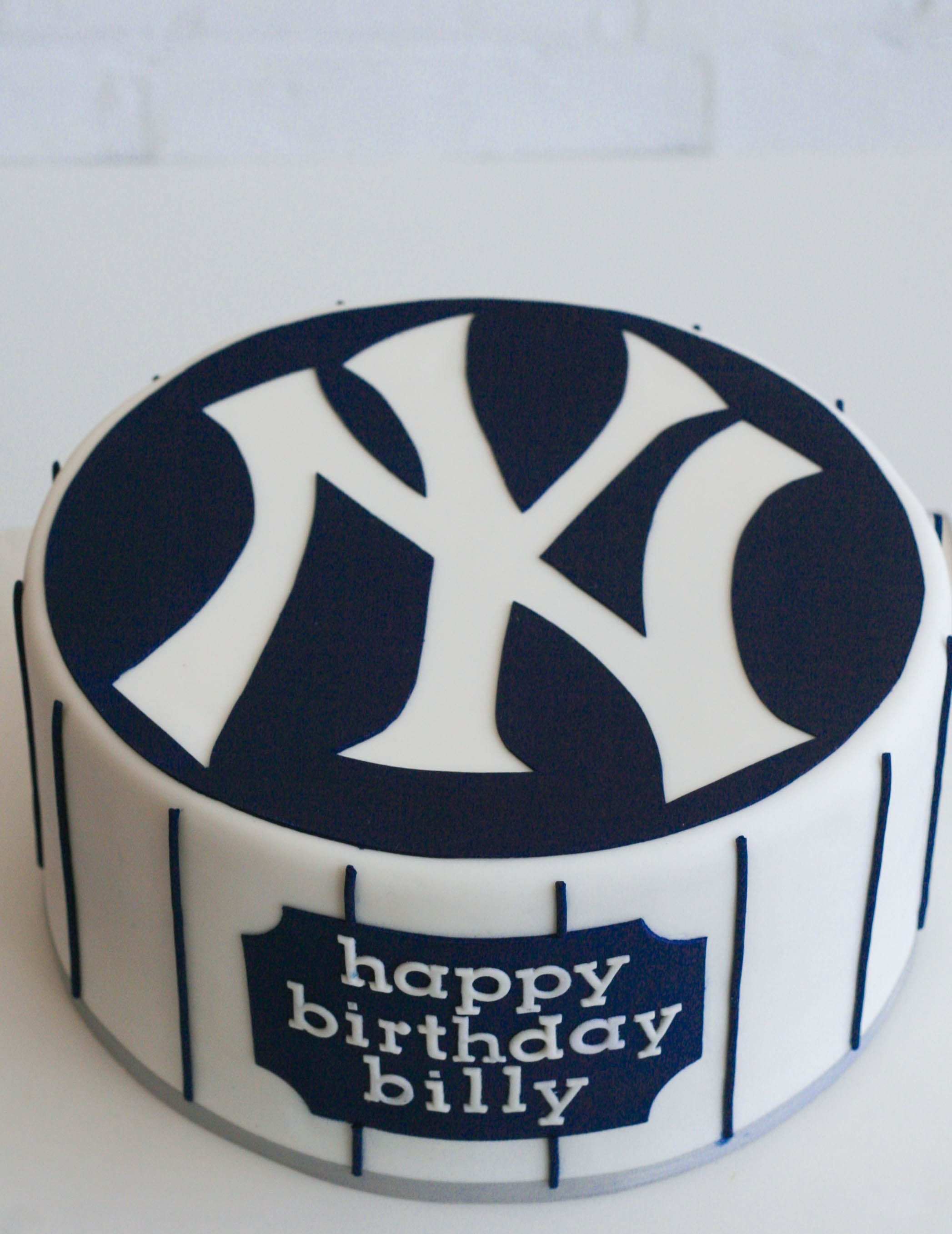 New york yankees birthday cake cakecentral new york yankees logo hand cut in the negative out of blue circle rather than being appliqued on fmm tappits alphabet letters used biocorpaavc Images