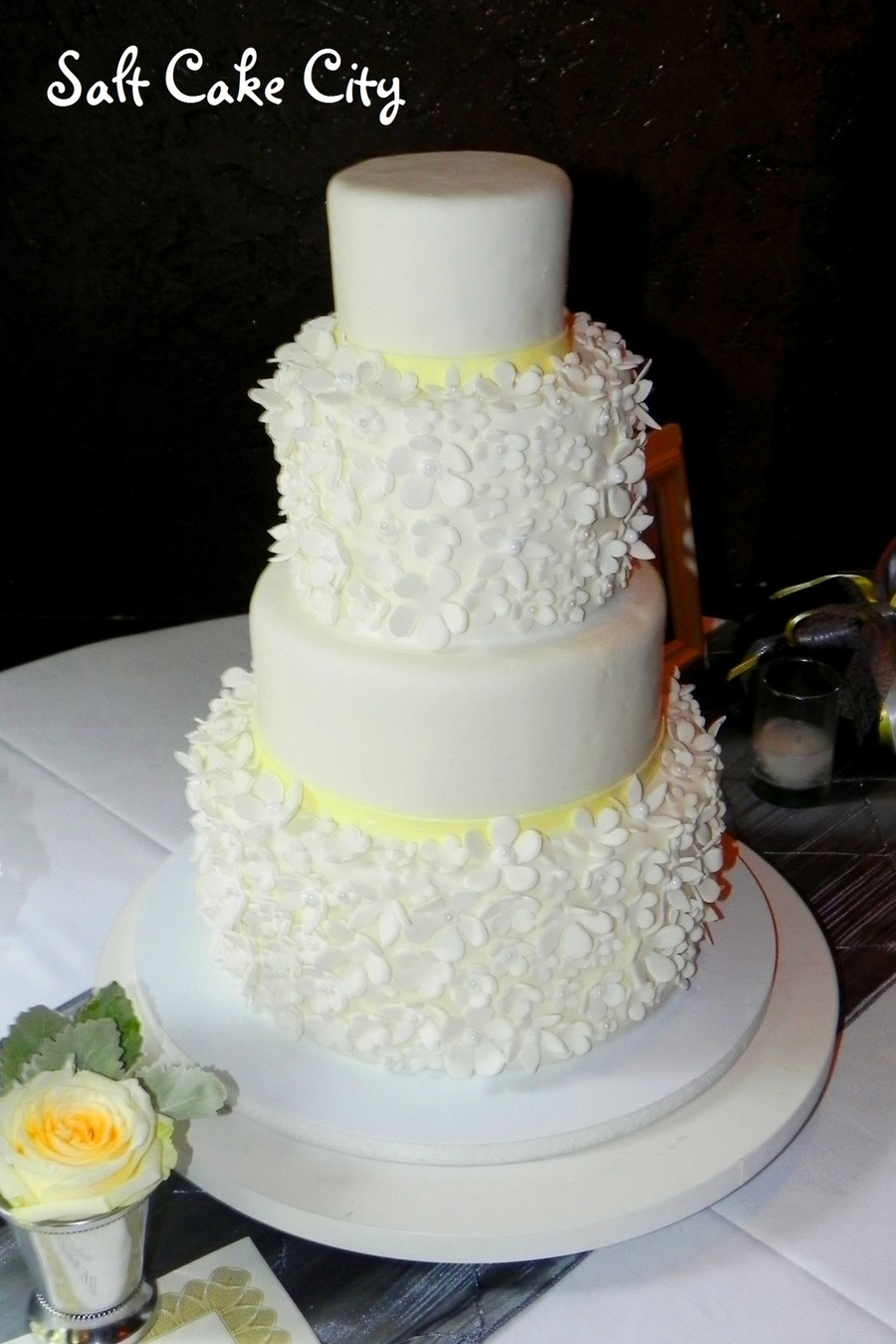 Extra Tall Flower Covered Tiered Wedding Cake on Cake Central