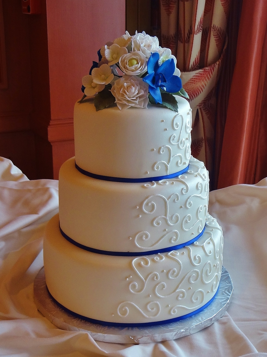 Scroll Piping With Royal Blue Ribbon And Gumpaste Flowers