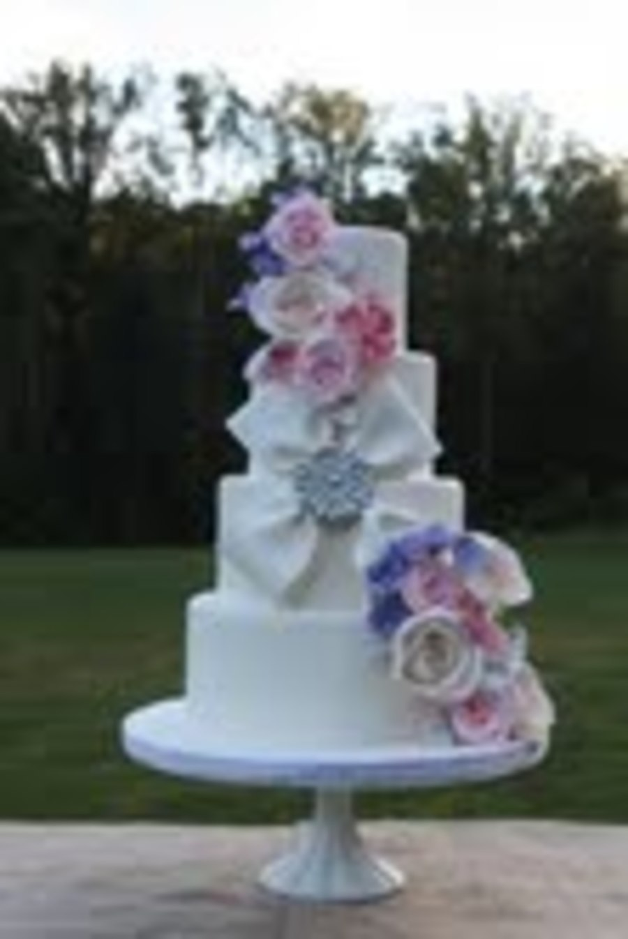 Flowers And Blingy Bow on Cake Central