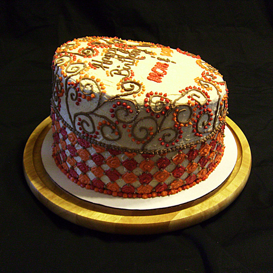 Single Tier Topsy Turvy Cake With Harlequin Pattern Around Bottom And Whimsical Swirl Pattern Around Top In Autumnal Colors All Piped Butte... on Cake Central