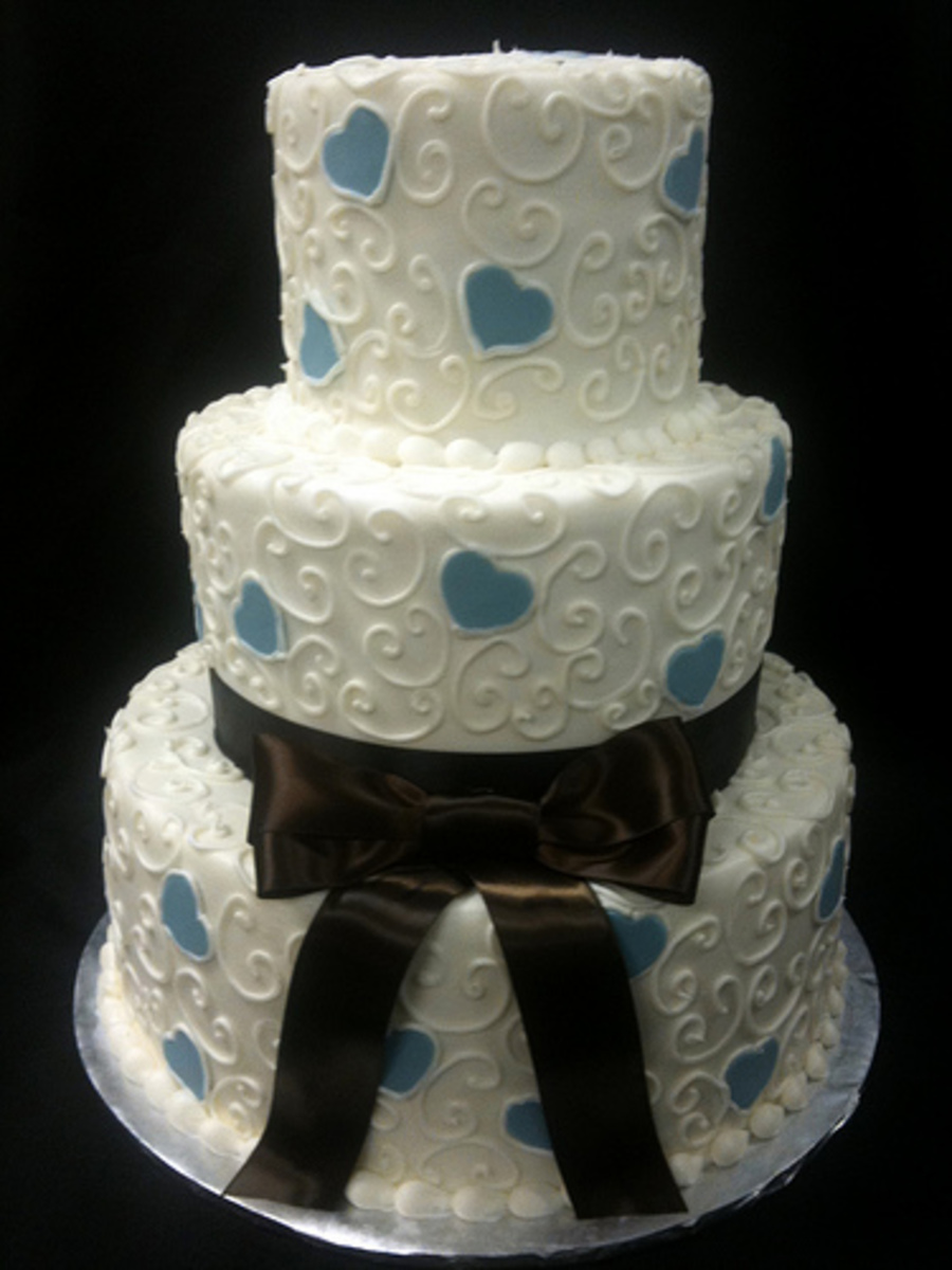 Off White Blue And Brown Ribbon Wedding Cake