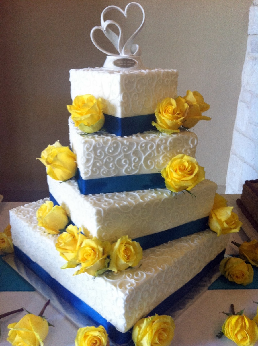 White, Blue And Yellow Wedding Cake - CakeCentral.com