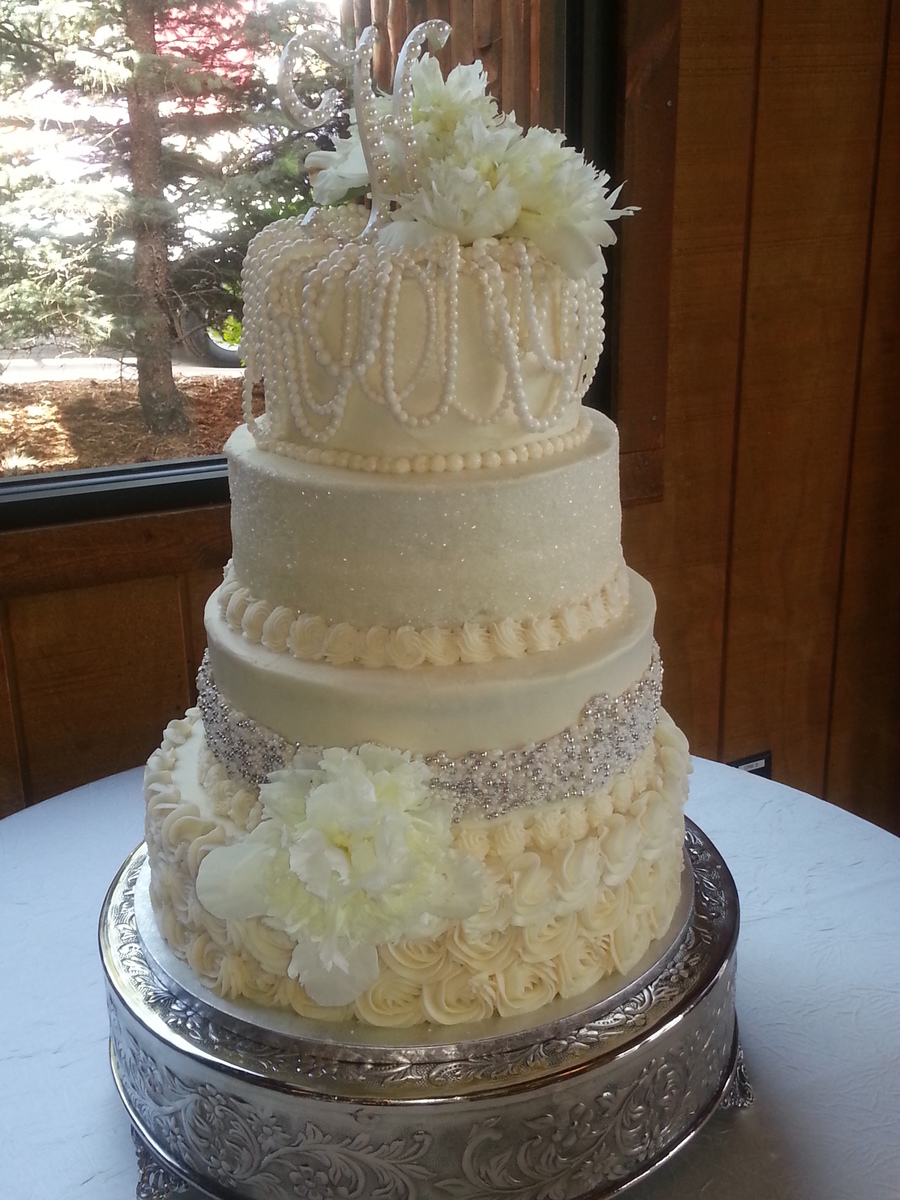 4 Tire Round Wedding Cake Decorated With Sugar Pearls Silver Dragees Sparkle Sugar And Rosettes ...