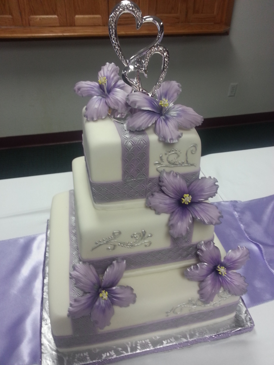 Lavender And Silver Wedding Cake With Sugar Hibiscus Flowers