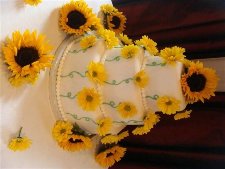Sunflower Wedding Cake With Yellow Daisies - CakeCentral.com