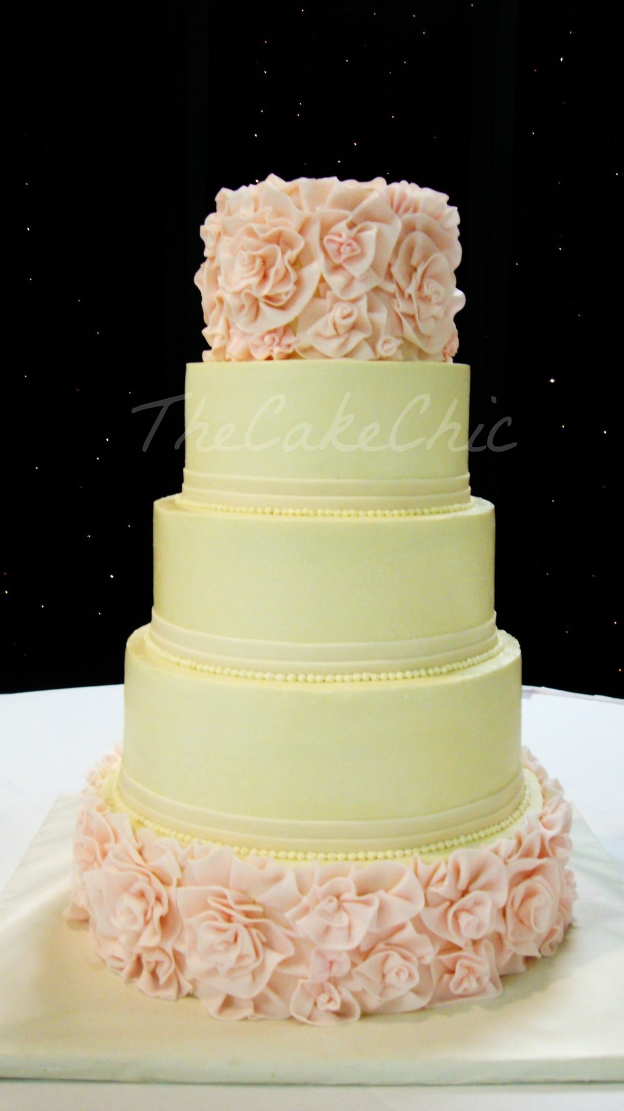 ivory and blush flower ruffle wedding cake from bottom. Black Bedroom Furniture Sets. Home Design Ideas